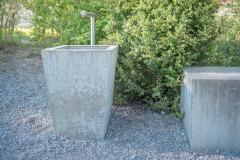 Trinkbrunnen. Dorfschulhaus